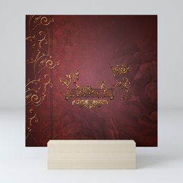 Music, clef with key notes on red background Mini Art Print