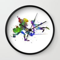 captain hook Wall Clocks featuring Peter Pan and Captain Hook in watercolor by Paulrommer