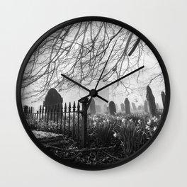 Rural church and graveyard in early morning fog. Hilborough, Norfolk, UK. Wall Clock