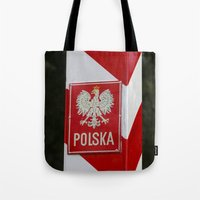 poland Tote Bags featuring Frontier between Poland and Germany by Premium