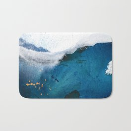 In the Surf: a vibrant minimal abstract painting in blues and gold Bath Mat