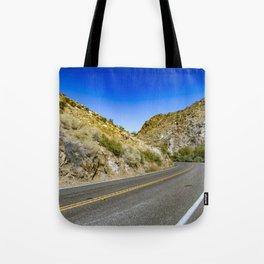 Highway Road Cutting through the Mountains in the Anza Borrego Desert, California, USA Tote Bag
