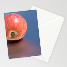 minimalist fresh red apple in the sun Stationery Cards