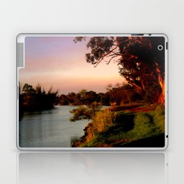 Reflecting sunset on the river Bank Laptop & iPad Skin