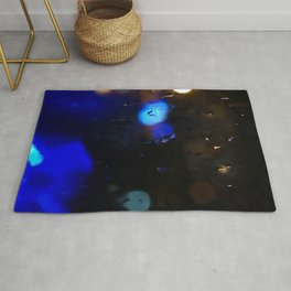 An abstract background with night lights and raindrops. Rug