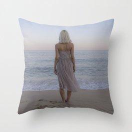 Girl in front of the ocean. Throw Pillow