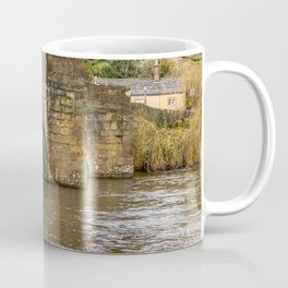 Ancient stone bridge crossing the River Wye in the town of Bakewell Coffee Mug