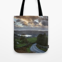 Steep mountain road 'the struggle' at sunset, with Lake Windermere beyond. Lake District, UK. Tote Bag