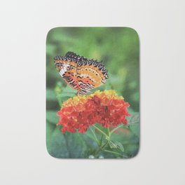 Spring butterfly on flowers in countryside Bath Mat