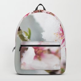Almond tree flowers covered by snow Backpack