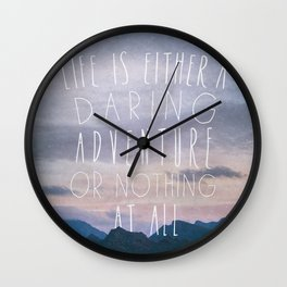 Life is either a daring adventure or nothing at all I Wall Clock