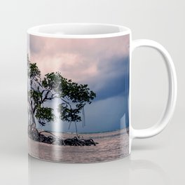 Small Trees on Floating Island Under Stormy Sky Coffee Mug