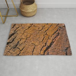 Orange tree bark with rustic wrinkles Rug