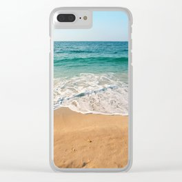 Sandy beach at noon with blue water and clear sky Clear iPhone Case