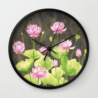 lotus flower Wall Clocks featuring Lotus by Carla Adol
