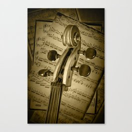 Scroll of a Cello Stringed Instrument in Sepia Tone with Classical Sheet Music Canvas Print