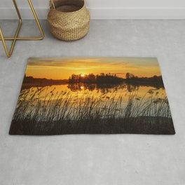 Sunset with trees reflection Rug