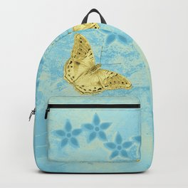 butterfly and flowers in an abstract blue grunge landscape Backpack