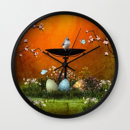 Easter eggs in the grass Wall Clock
