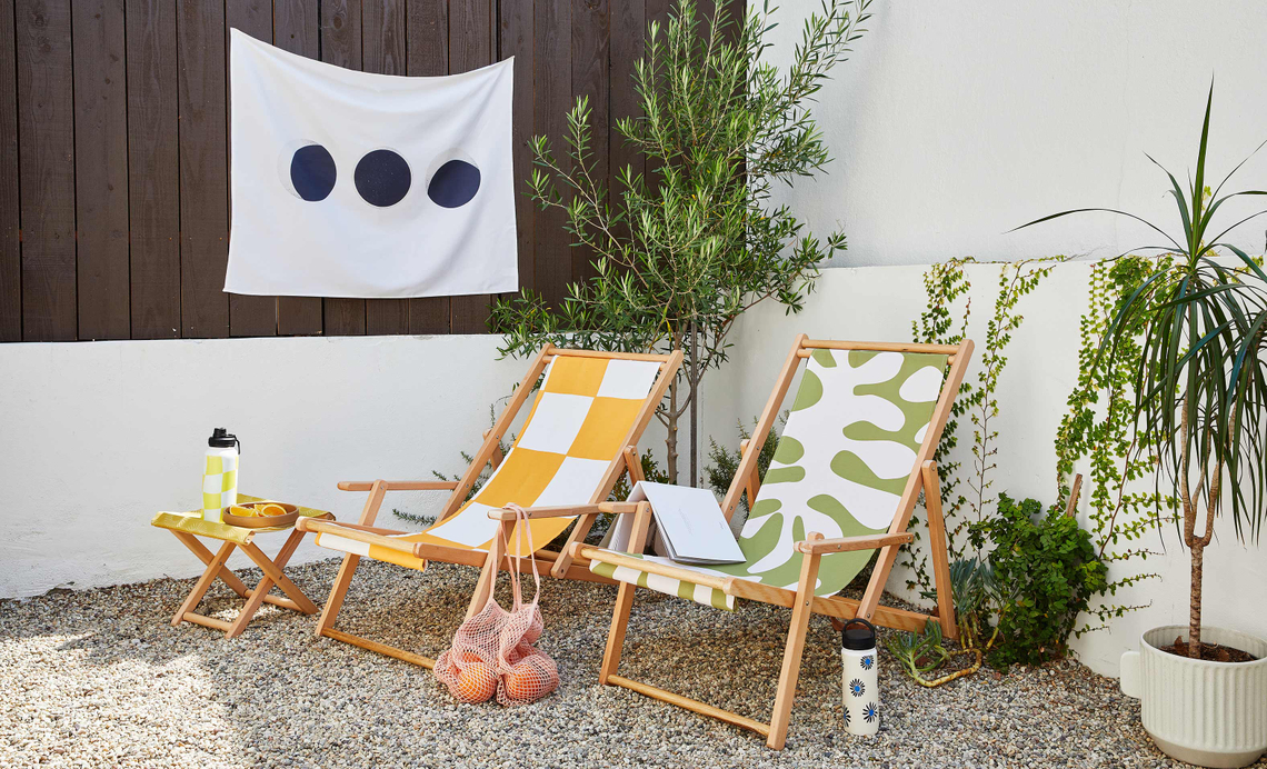 backyard setup with sling chairs, folding stool, water bottle and more