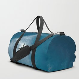 Lonely airplane in the blue sky Duffle Bag