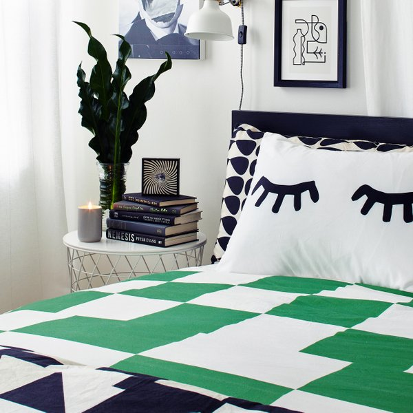 bed with green and white checkered duvet cover