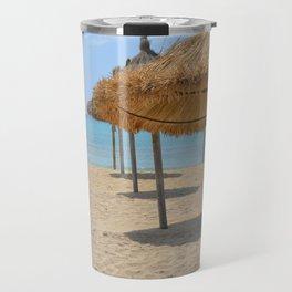 Parasols in a row on a sunny beach Travel Mug