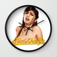 wiz khalifa Wall Clocks featuring Mia Khalifa by MartiniWithATwist
