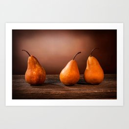 Three large yellow bosc pears on a barn wood table Art Print