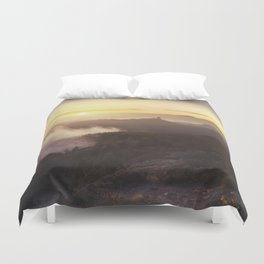 Sunset over the clouds Duvet Cover