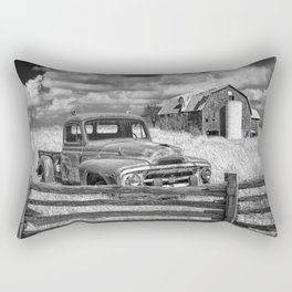 Black and White of Rusted International Harvester Pickup Truck behind wooden fence with Red Barn in Rectangular Pillow