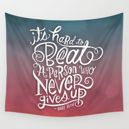 It's Hard to Beat a Person Who Never Gives Up Wall Tapestry