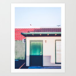 green wood building with brick building in the city Art Print