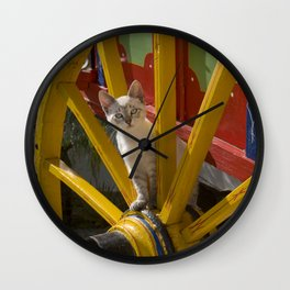 kitten playing on an Algarve cart, Portugal Wall Clock