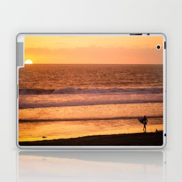 Surfer watching sunset in Southern California Laptop & iPad Skin