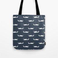 blackhawks Tote Bags featuring blue hawks by Let it Rain