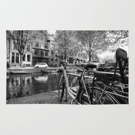 Bicycles and boats along Amsterdam canal Rug