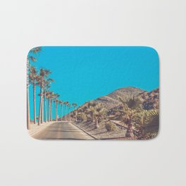 Andalusia street with palm trees at sunset. Retro toned Bath Mat