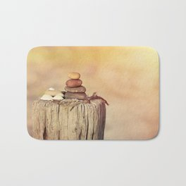Balanced stone cairn in sunset light Bath Mat