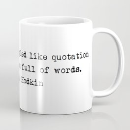 """""""The two of us snuggled like quotation marks in his room full of words."""" -Michelle Hodkin Coffee Mug"""
