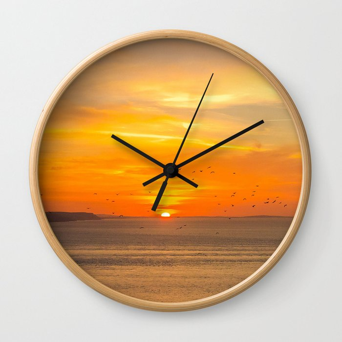 Sunset Coast with Orange Sun and Birds Wall Clock