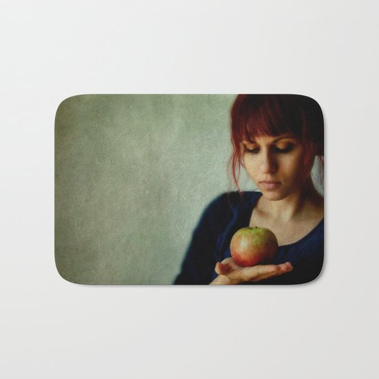 the girl with the apple Bath Mat