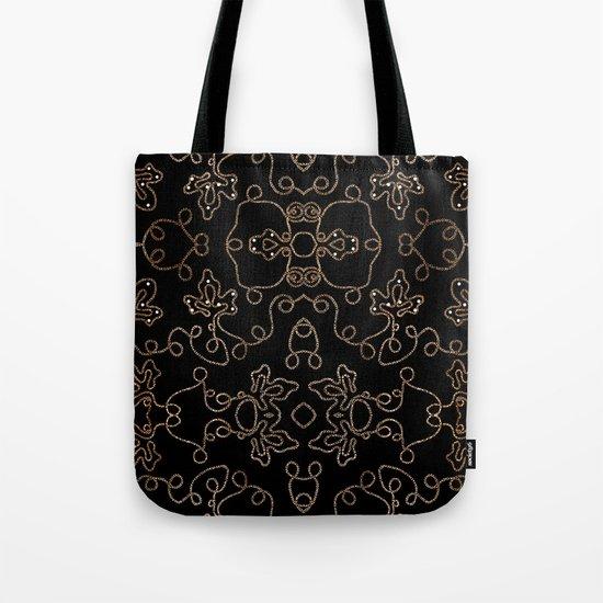 Elegant gold embellishments on black Tote Bag