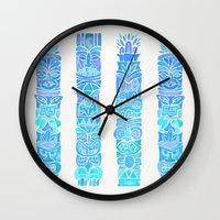 tiki Wall Clocks featuring Tiki Totems – Turquoise Palette by Cat Coquillette