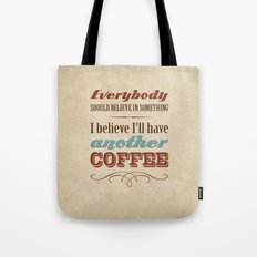 Everybody should believe in something. I believe I'll have another coffee. Tote Bag