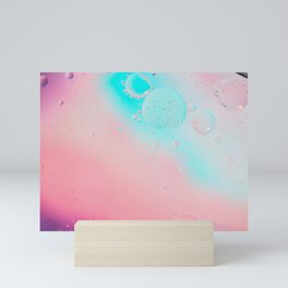 Oil drops in water. Defocused abstract psychedelic pattern image pastel colored. Abstract background with colorful gradient colors. Mini Art Print