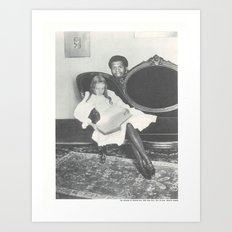 Kareem Abdul Jabbar hiding behind a little girl reading a book on a sofa Art Print