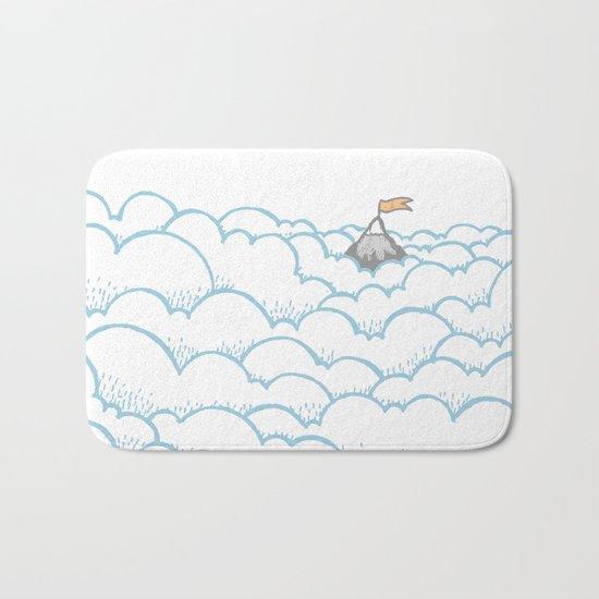 Peak above the clouds Bath Mat