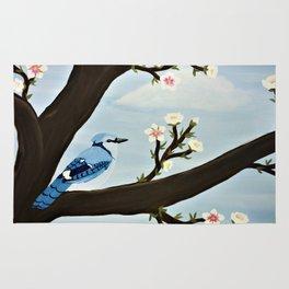 Blue Jay on Almond Blossom Tree Rug