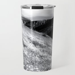 poppy flower field with mountain and cloudy sky background in black and white Travel Mug